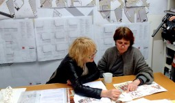 Yvonne Farrell and Shelley McNamara of Grafton Architects examine one of their notebooks